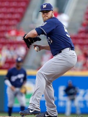 Brewers starter Jimmy Nelson pitches Thursday in the first  inning against the Reds at Great American Ball Park in Cincinnati.