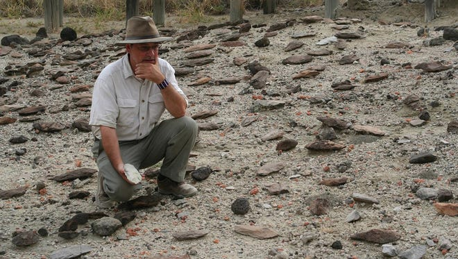Richard Potts with artifacts in the Olorgesailie Basin in southern Kenya.