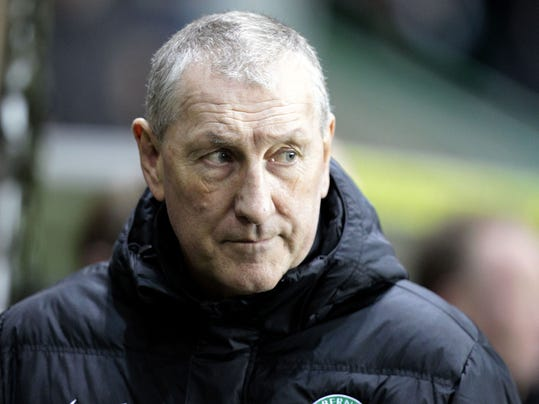 FILE - This is a Feb. 28, 2014 file photo  of Hibernian's manager Terry Butcher. The Scottish soccer team  Hibernian have sacked manager Terry Butcher following their relegation from the Scottish Premiership, the club have announced on their website Tuesday June 10, 2014. (AP Photo/ Graham Stuart/PA) UNITED KINGDOM OUT