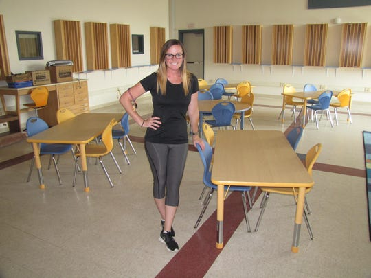 Kristen Kramarik, coordinator of family and community partnership for Finn Academy, stands in a third-grade classroom on the ground floor of their building.