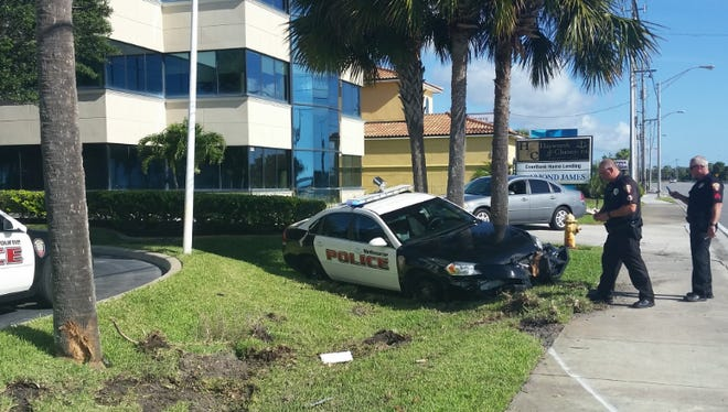A Melbourne police cruiser was damaged in a crash while pursuing a suspect near downtown Melbourne Thursday morning.