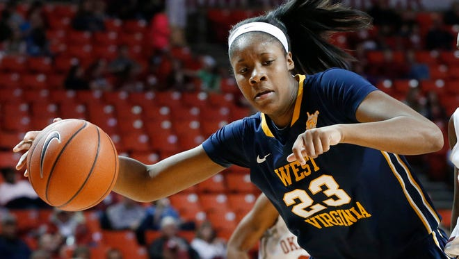 West Virginia guard Bria Holmes drives around Oklahoma guard T'ona Edwards during the first half in Norman, Okla.