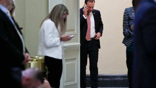 "Sen. Mike Lee, R-Utah, talks on his cellphone outside a Senate Republican meeting on Capitol Hill in Washington on Tuesday, July 18, 2017. President Donald Trump blasted congressional Democrats and ""a few Republicans"" over the collapse of the GOP effort to rewrite the Obama health care law."