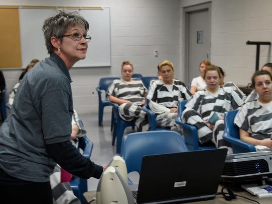 Sherrie Montgomery, director of the Jefferson County Health Department,  starts a video showing the inconsolable whimpers and twitches of a newborn baby exposed to drugs in his mother's womb to inmates at the Jefferson County Justice Center on Jan. 18, 2017, in Dandridge, Tenn.