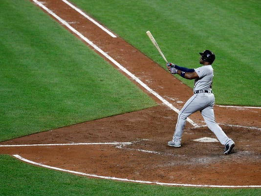 Detroit Tigers' Justin Upton watches his grand slam in the eighth inning of a baseball game against the Baltimore Orioles in Baltimore, Friday, Aug. 4, 2017. (AP Photo/Patrick Semansky)