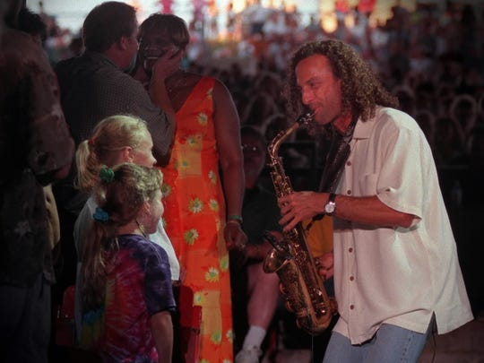 Kenny G performs for two young girls in the audience at the Marcus Amphitheater, Sunday evening, June 28, 1998.