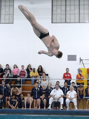 Pittsford's David Petrison performs a dive.