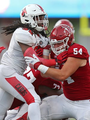 True freshman Coy Cronk (54) started every game at offensive tackle for Indiana.
