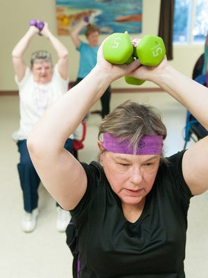 Kate Fahrbach, 67, works out with other during the MountainView Senior Circle Wellness Workout.