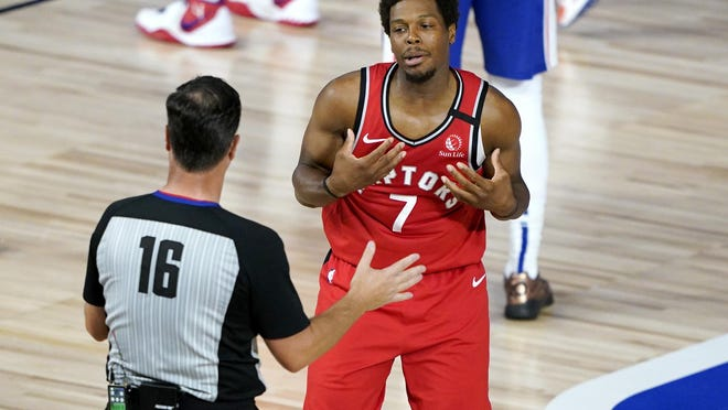 Toronto's Kyle Lowry reacts after referee David Guthrie (16) called him for a technical foul during the first half of Wednesday's game against the Philadelphia 76ers in Lake Buena Vista, Fla.