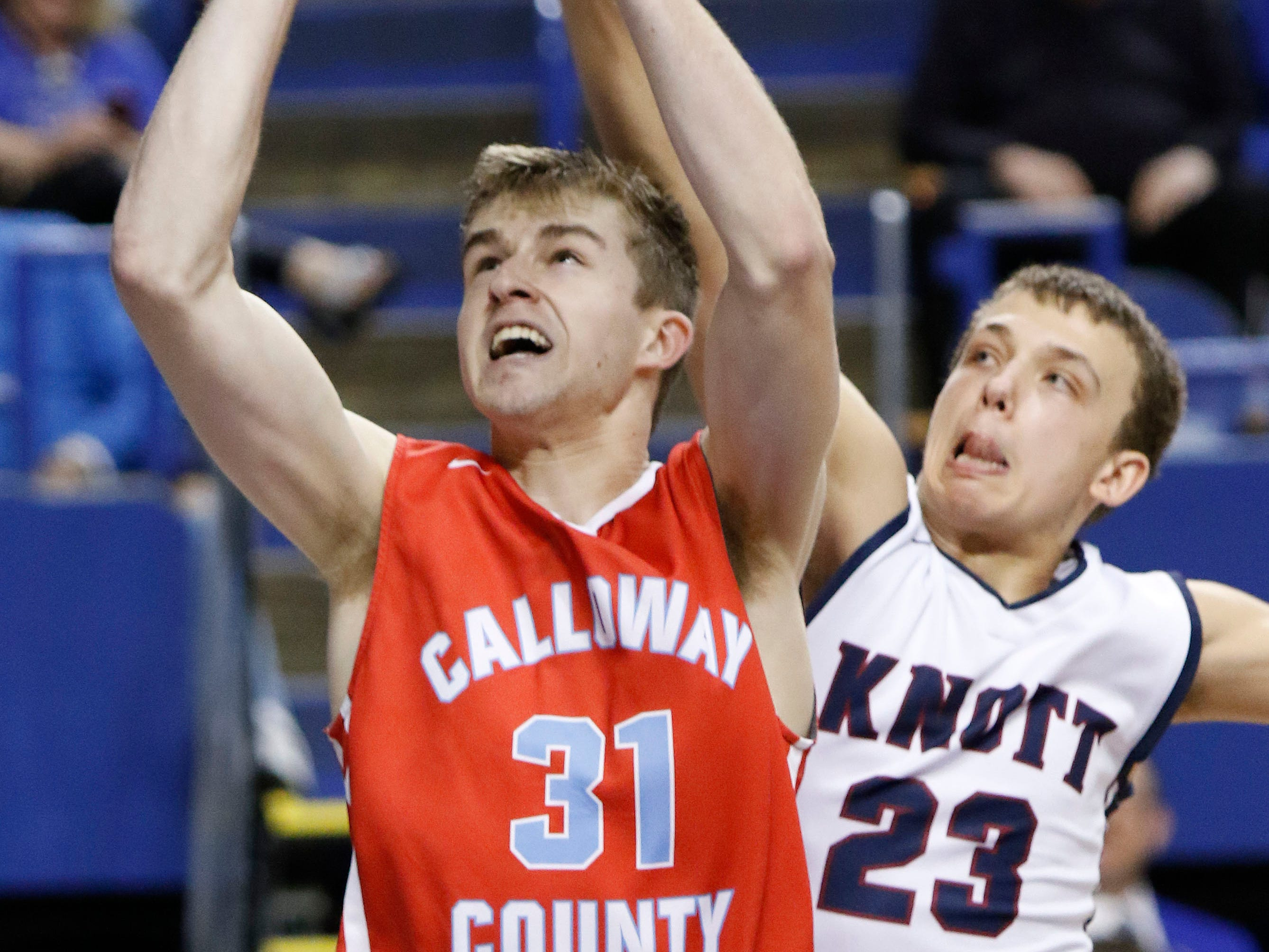 Calloway County's Skyler Hunter (31) shoots against Knott County Central's Isaac Caudill (23) during a first-round KHSAA Sweet 16 game Thursday in Lexington, Ky.