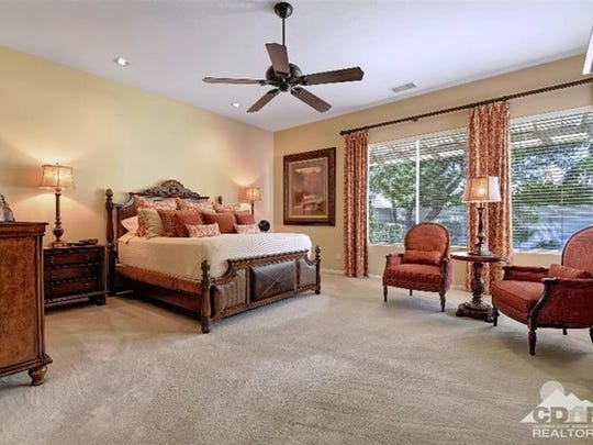 The expansive master bedroom in a Versailles house.