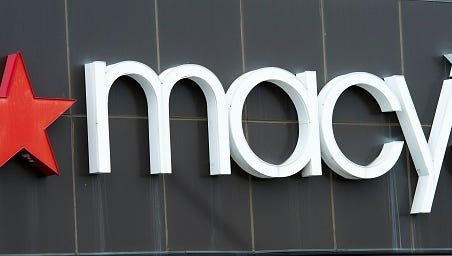 The exterior of a Macy's department store is seen at the Fair Oaks Mall on January 5, 2017, in Fairfax, Virginia. Investors hammered retailers early January 5, 2017 as US stocks opened near flat following reports of disappointing holiday sales from department stores Macy's and Kohl's. Macy's slumped 12.8 percent and Kohl's 17.2 after both reported lower sales in the critical November-December period. Macy's also said it plans to cut as many as 10,100 jobs in a response to the decline of shopping in stores due to the rise of e-commerce.  / AFP / Paul J. Richards        (Photo credit should read PAUL J. RICHARDS/AFP/Getty Images)
