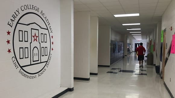 A student walks downt the Clint Early College Academy hallway.