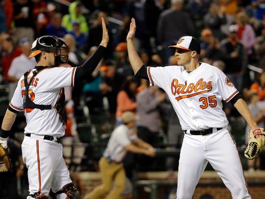 Baltimore Orioles reliever Brad Brach and catcher Matt