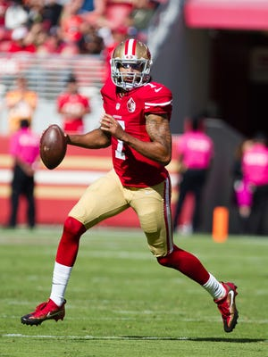 49ers quarterback Colin Kaepernick looks to pass the ball against the Tampa Bay Buccaneers on Sunday.