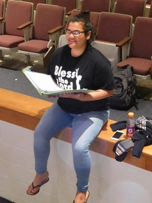 """Assistant student director Isabella Claudio holding the show's """"bible"""""""