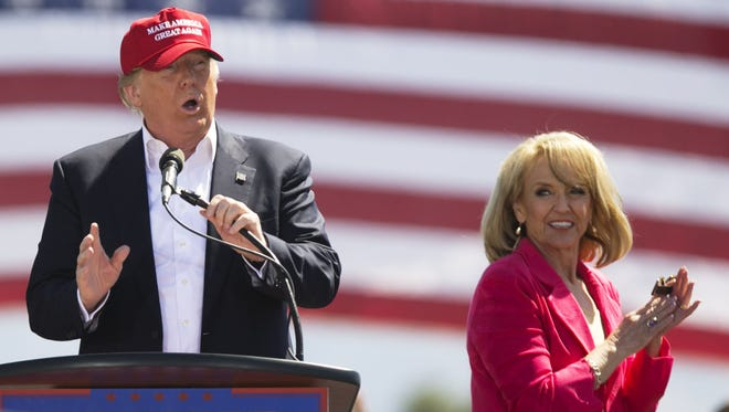 Former Arizona Gov. Jan Brewer was a prominent early backer of now-President Donald Trump. Brewer applauds then-Republican presidential candidate Donald Trump at a March 19, 2016, rally in Fountain Hills.