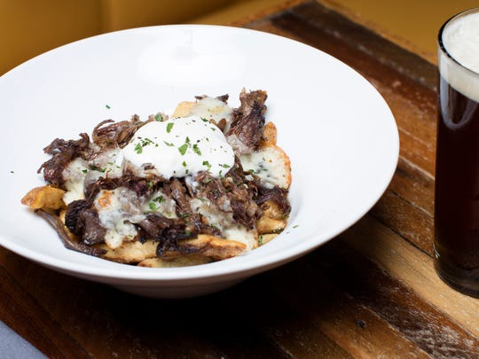 """Short rib poutine at The Hub on Frankfort Avenue, which includes braised beef, local curds, house fries, braising jus and buttermilk crŽeme fra""""che."""