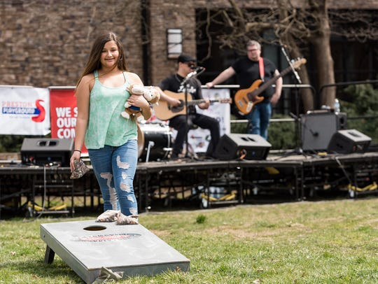 Zoe  Kneipp ,12, of Newark, plays cornhole at Wine