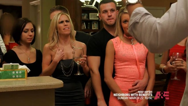 """A still from """"Neighbors With Benefits"""" on A&E"""