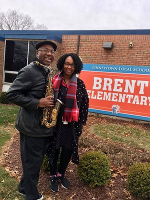 Ed Thomas and his wife, Ingrid Jarmon-Thomas, in front of Brent Elementary School in Finneytown Friday, where she is a teacher.