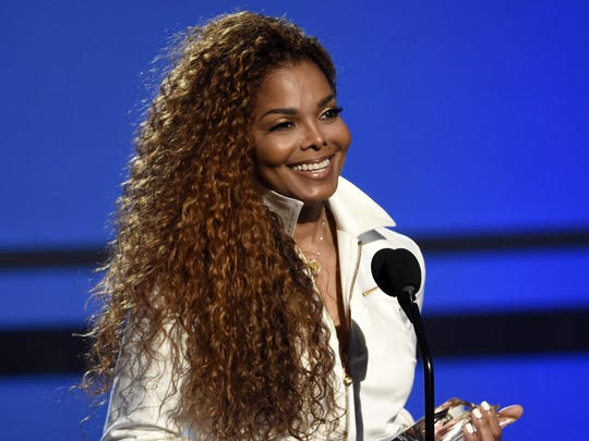 In this June 28, 2015, file photo, Janet Jackson accepts the ultimate icon: music dance visual award at the BET Awards in Los Angeles.