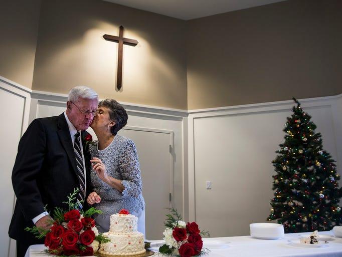 Denise Praz kisses her husband, Joseph Mazur, after