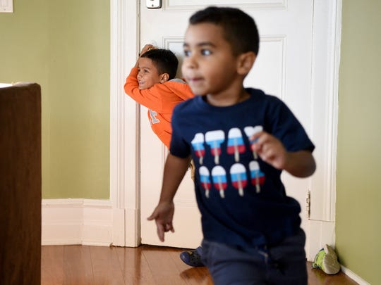 Cousins Sebastian Rivera, 6, and Andrew Amy, 4, of