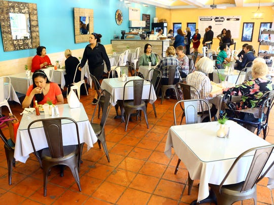 People eat lunch and socialize during their lunch hour Thursday Jan. 29, 2015 at Hester's Cafe & Coffee Bar in Corpus Christi.