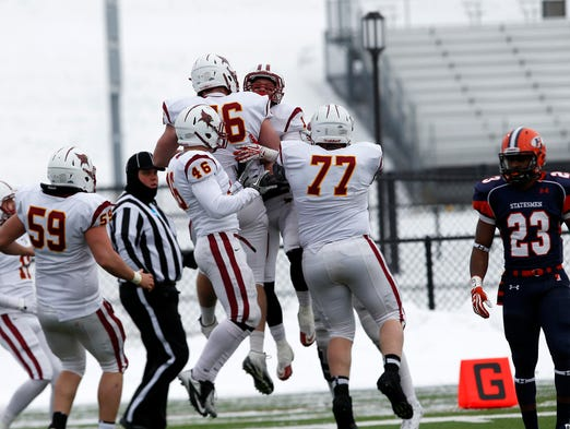 St. John Fisher celebrates a TD in a 27-6 win over Hobart Saturday.