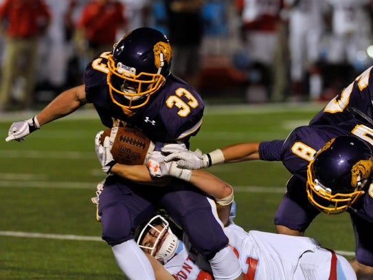 Wylie High School's Brady Horn tries to pull away from