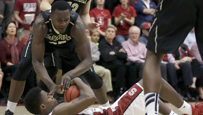 Stanford's Marcus Allen, bottom, tries to control the ball against Vanderbilt's James Siakam in last week's NIT game.
