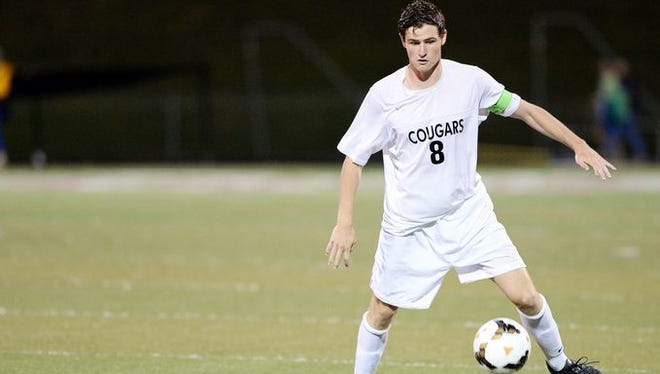 Asheville High senior Davis Brooks has committed to play college soccer for Queens.