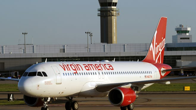 This photo from April 24, 2014, shows a Virgin America plane at Dallas Love Field.