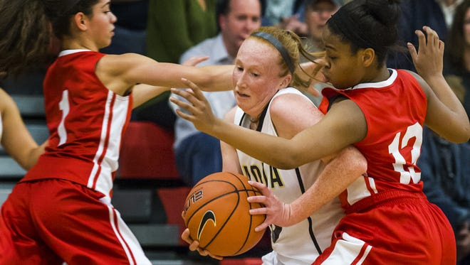 Padua's Megan Mallon gets trapped by Alisha Lewis (1) and Sabriya Harris (13) of top-ranked Ursuline last Thursday.