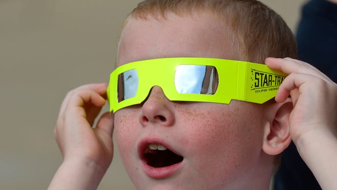First grade student Jack Druck, 7, uses glasses for viewing eclipses to view the planet Mercury as it passes in front of the sun, Monday May 9, 2016 at Wrightsville Elementary School. Mercury makes the transit every eight years on average with the last in 2006 with the next in 2019. Venus is the only other planet in our solar system to pass between the Earth and the sun with the next transit in 2117.John A. Pavoncello photo