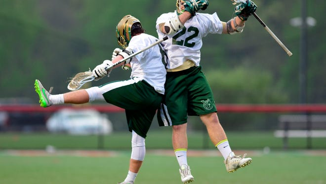 York Catholic's Tommy Bowser, left, and Luke Brenman celebrate at goal against Central York during the YAIAA semi-final, Tuesday May 10, 2016.John A. Pavoncello photo