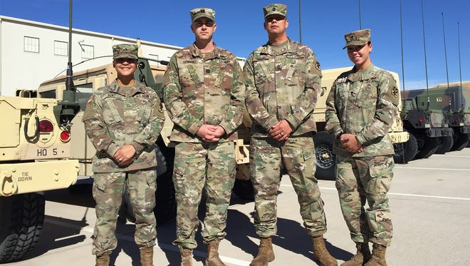 Members of Headquarters and Headquarters Battery, 11th Air Defense Artillery Brigade include, from left, Pfc. Tatiana Hunt, Capt. Doug Cannon, 1st Sgt. Gary Quinto and Spc. Savannah Krekelberg.