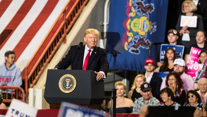 President Donald Trump addresses the crowd during a rally at the Farm Show Complex in Harrisburg on Saturday, the 100th day of his presidency.