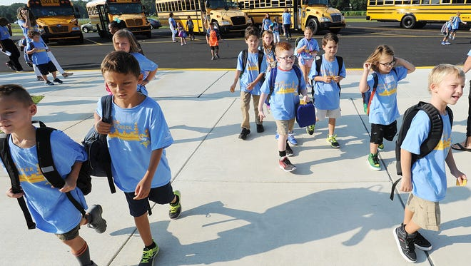 Students start their first day of school at the new Love Creek Elementary school in Lewes, Del. on Tuesday, Sept. 5, 2017.