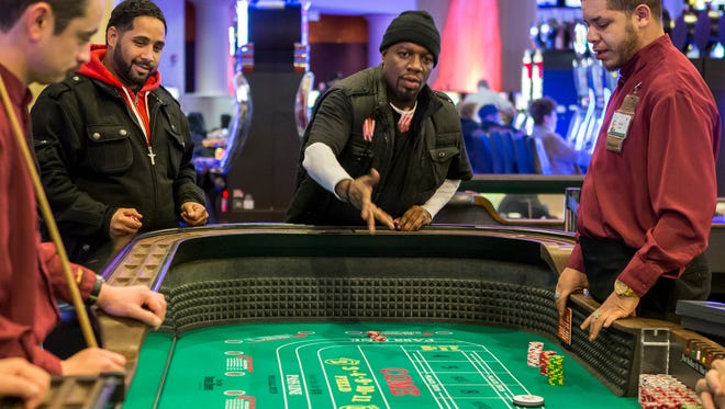 Mike Brown tosses the dice as he plays craps at Dover Downs Casino in Dover.