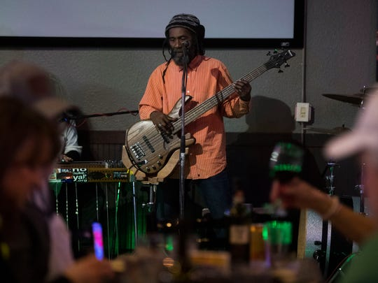 A member of the Natti Love Joys plays to patrons at the Tennessee Tap House in Bearden on Friday, Jan. 5, 2018.