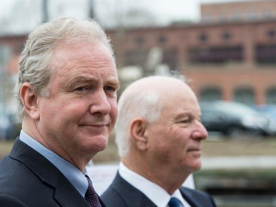 U.S. Sens. Chris Van Hollen, left, and Ben Cardin announced federal funding for oyster restoration efforts in Washington.