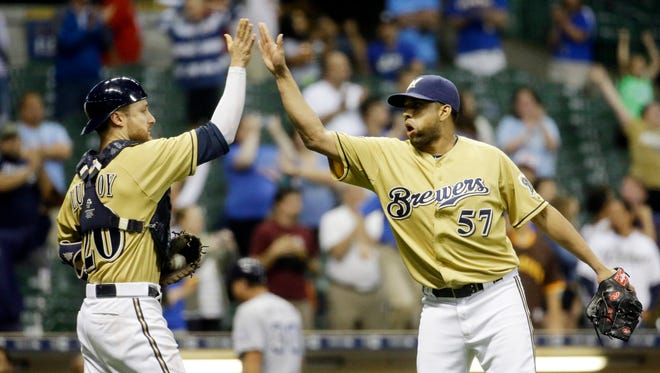 Milwaukee Brewers catcher Jonathan Lucroy and relief pitcher Francisco Rodriguez celebrate after  a baseball game against the San Diego Padres Wednesday, Aug. 5, 2015, in Milwaukee. The Brewers won 8-5.