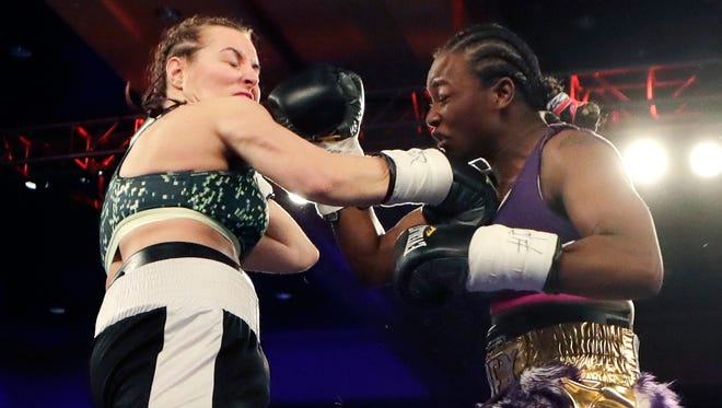 Claressa Shields, right, fights Szilvia Szabados in March