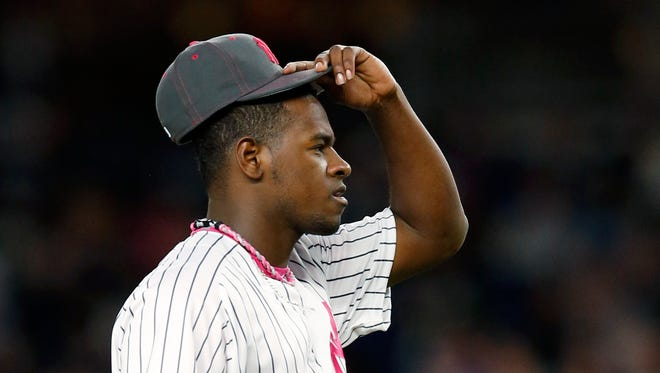 New York Yankees starting pitcher Luis Severino (40) reacts during the first inning of a baseball game against the Boston Red Sox in New York, Sunday, May 8, 2016.