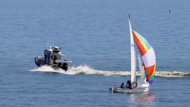 A rescue boat speeds out onto Lake Michigan after receiving a distress call Thursday afternoon.
