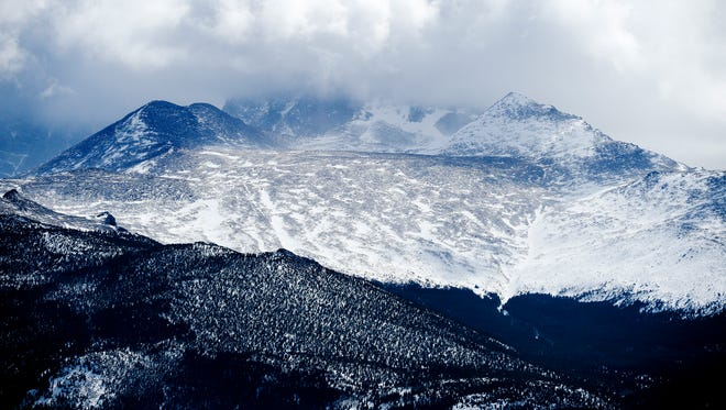 Longs Peak is covered in the clouds Thursday, March 26, 2015.