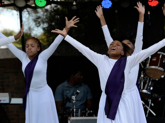 Antionette Chambers, right, and the Madison Community Center Praise Dancers perform during the African Street Festival at Hadley Park.